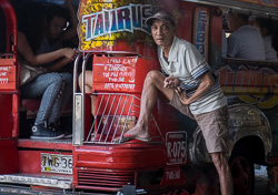A barker at the rear of his jeepney, Marikina